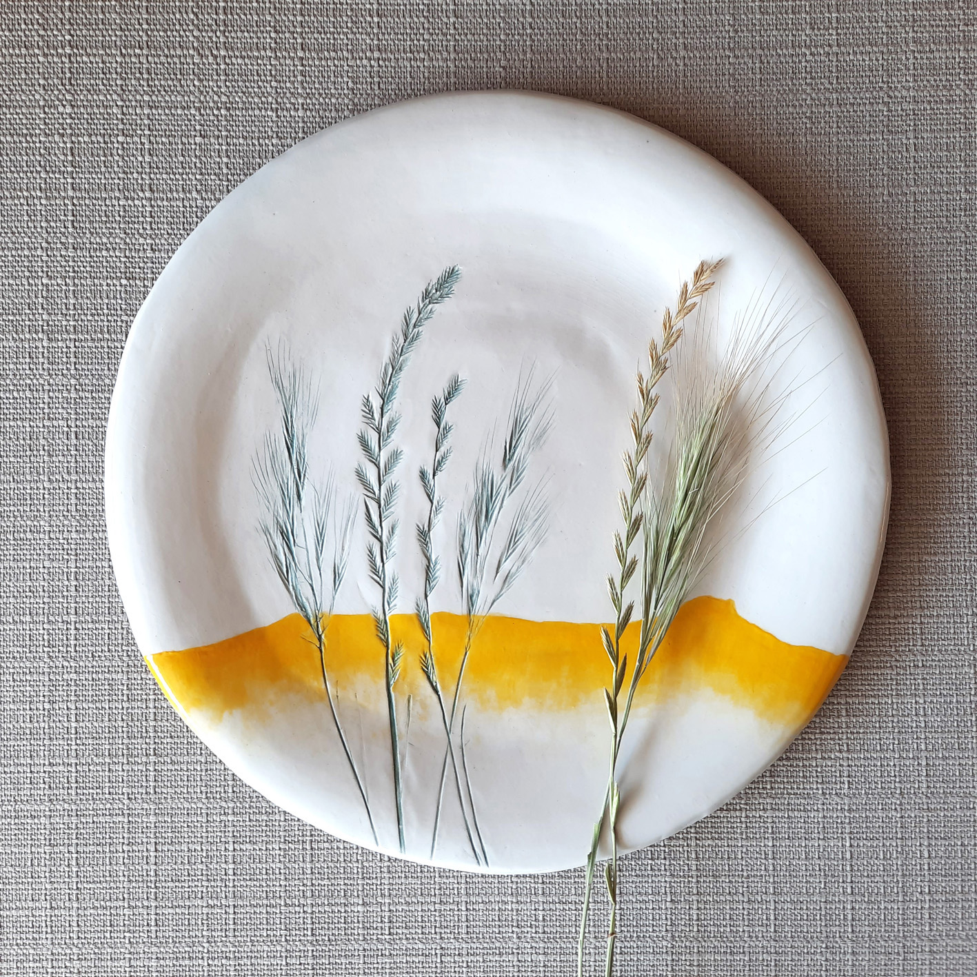 White plate with grass
